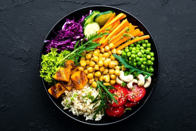 A black bowl with MMiddle Eastern ingredients