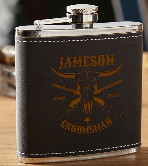 Black leather flask with a golden brown engraving.