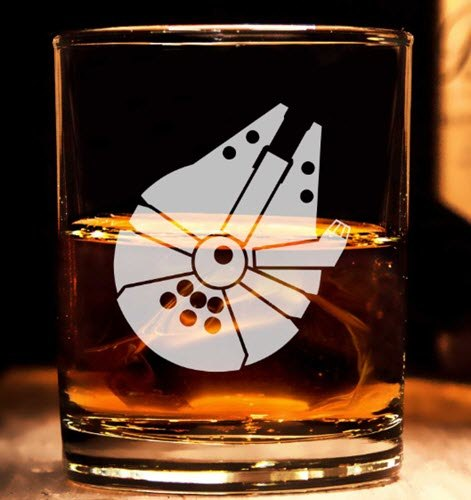 A whiskey glass with the millennium falcon on it