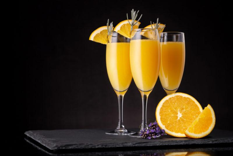 Three mimosas in cocktail glasses