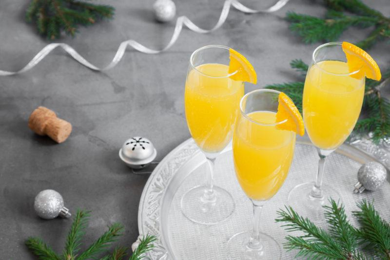 Three mimosas on a silver tray