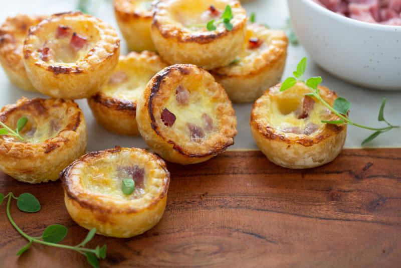 Small quiches on a wooden board