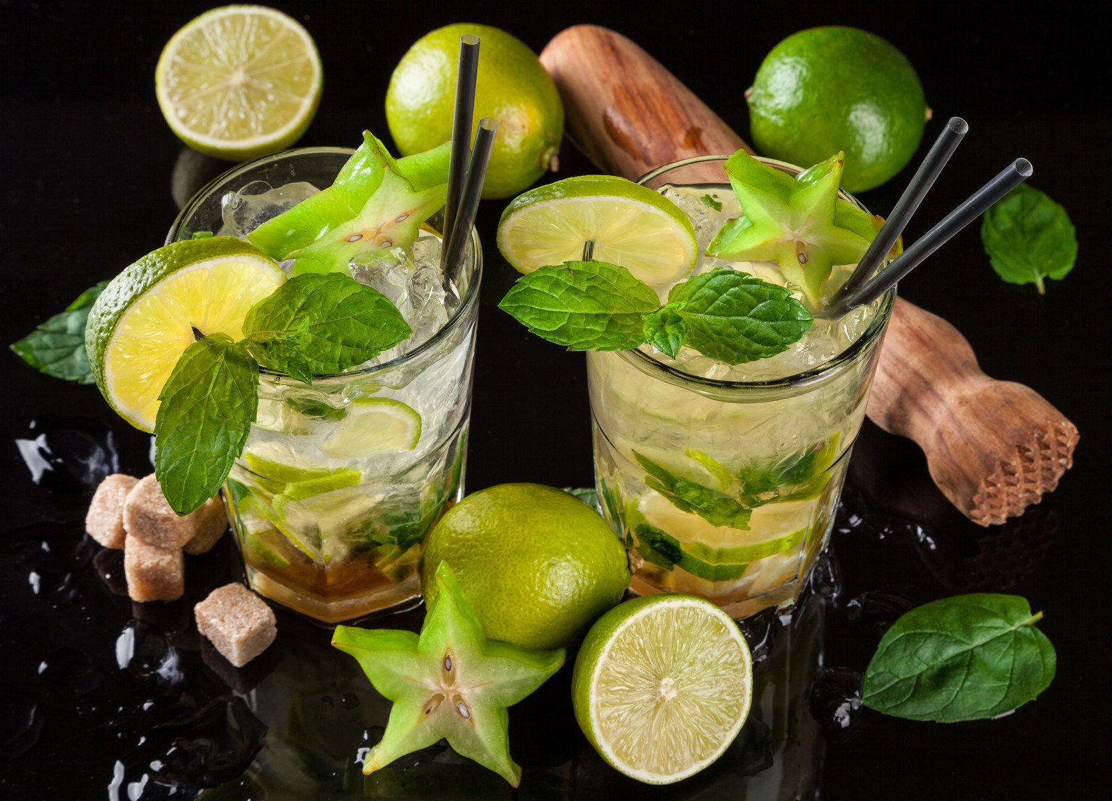 Mojito drinks  prepared by a blender and served on black stone