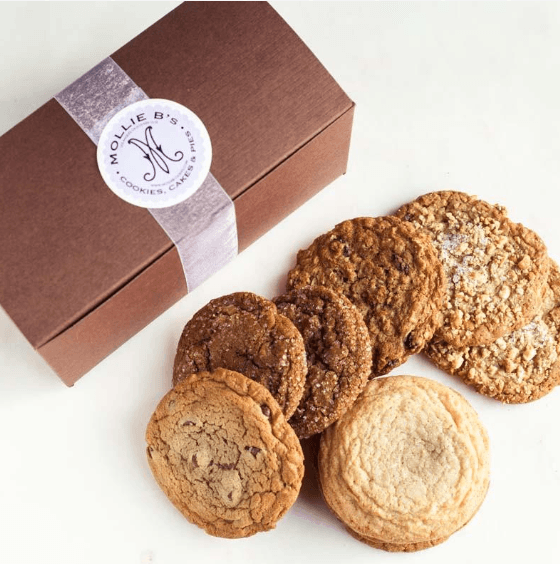 A cardboard box with various cookies