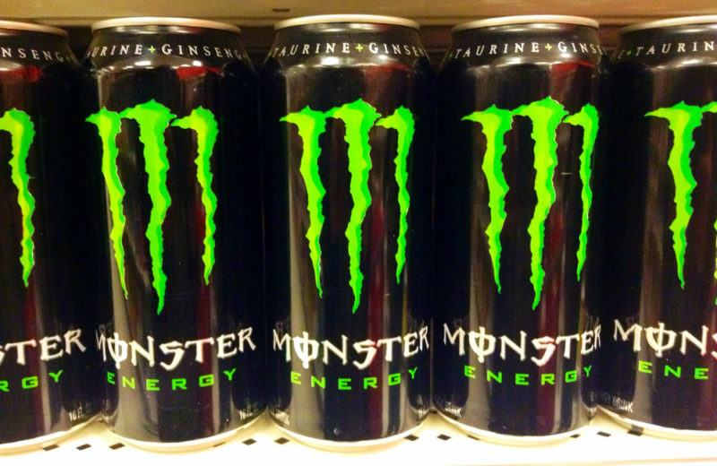 Five cans of Monster Energy Drink with the green M on the front