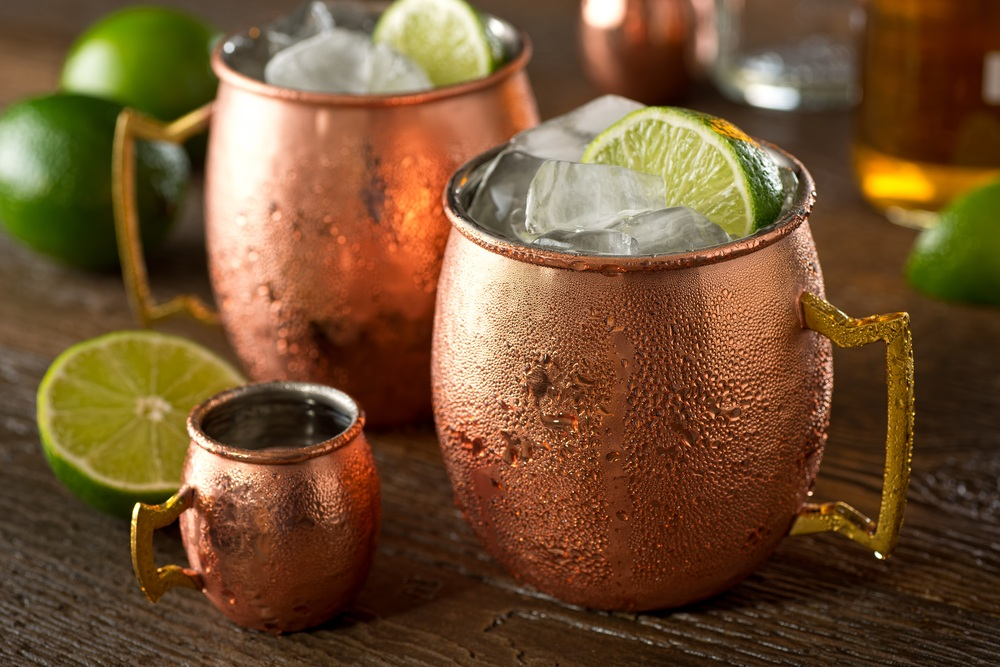 Two Moscow mule cocktails in copper mugs