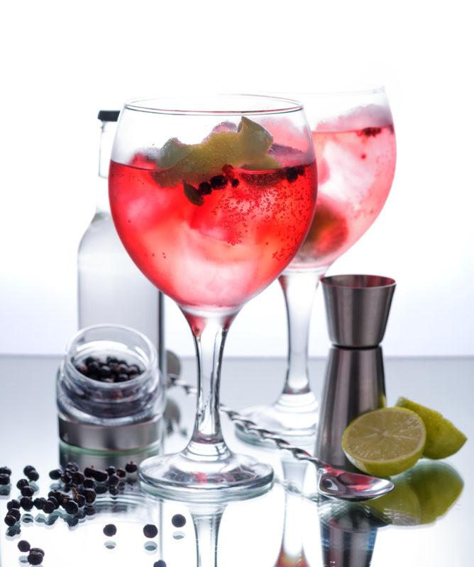 Muddled strawberries in a gin and tonic