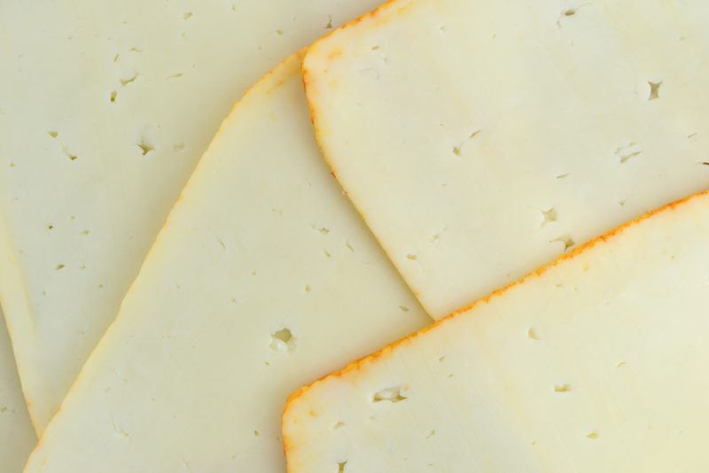 Slices of Munster cheese spread out