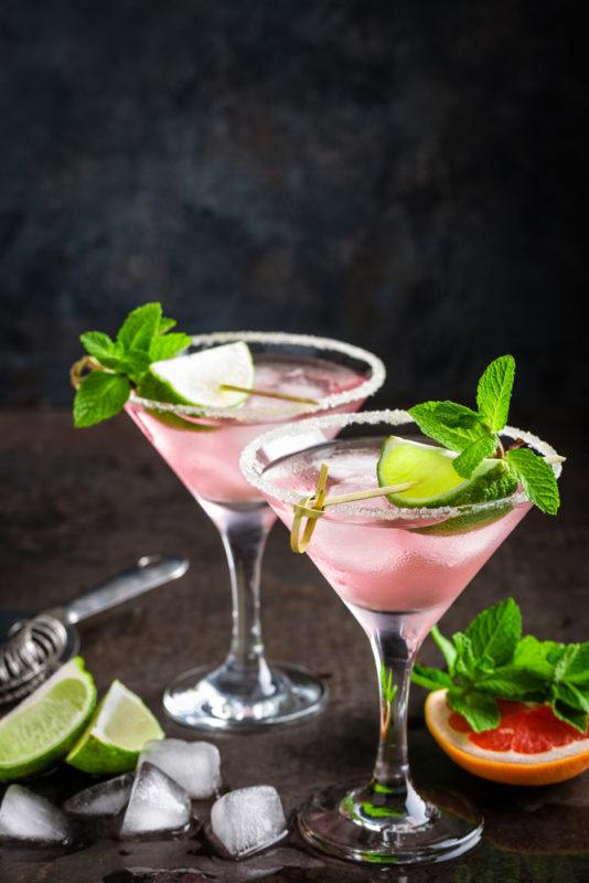 Two grapefruit cocktails in martini glasses