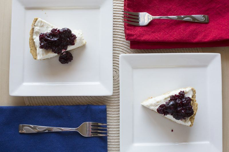 No-Bake Cheesecake Cherry Compote Top Down Square Plate Two Servings Dessert