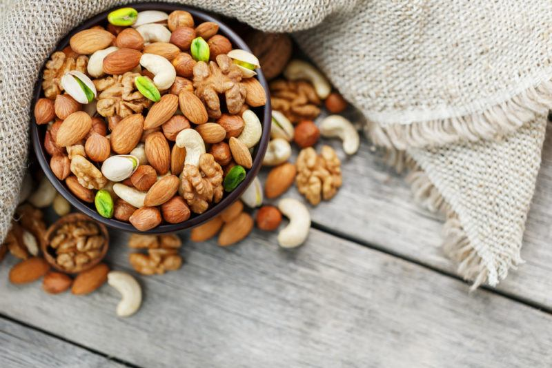 A bowl containing various types of nuts