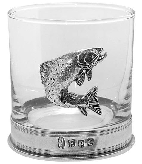 A whiskey glass with a pewter fish and base