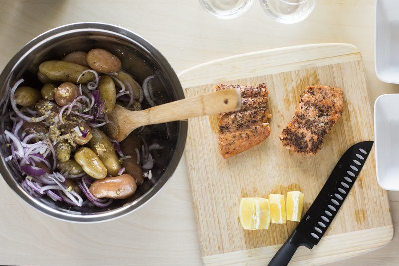 Olive Oil Poached Salmon with Fingerling Potatoes and Tarragon Assembly Shot Top Down Onions Lemon