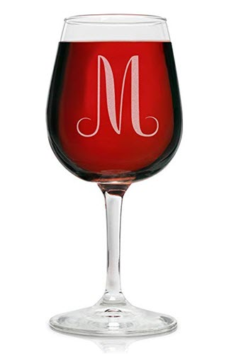 Red wine in a glass with an engraved 'M'