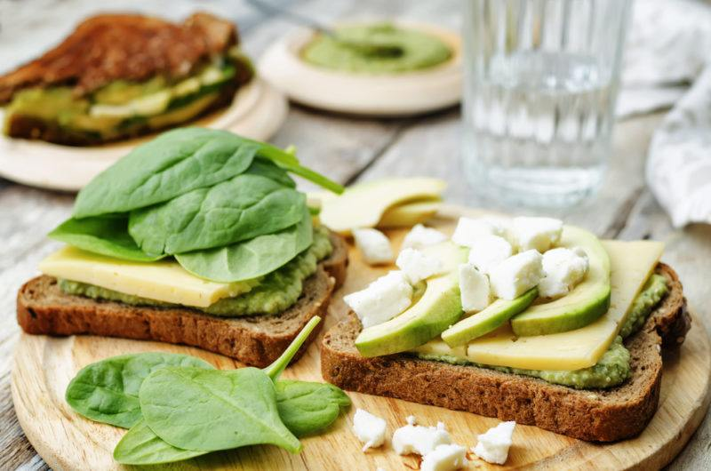 Open face sandwich with spinach and avocado