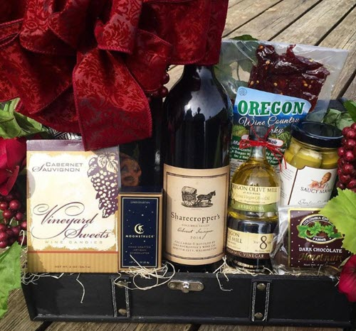 A trunk with various sweets and wine.