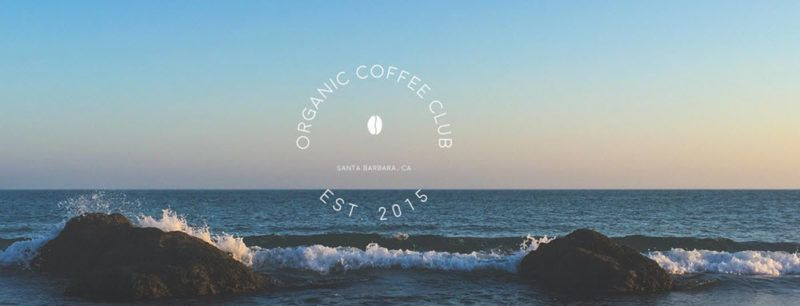 The website for Organic Coffee Club, showing an image of the ocean with rocks and waves