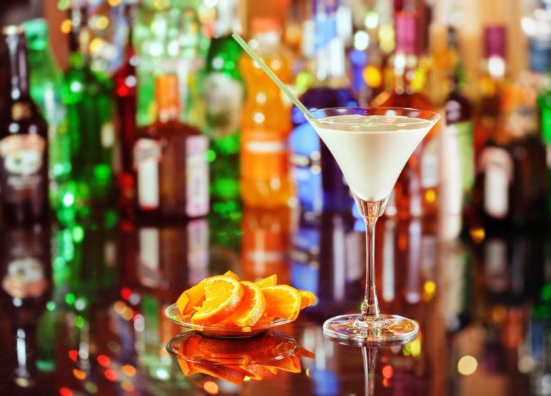 An orgasm cocktail on a crowded bar