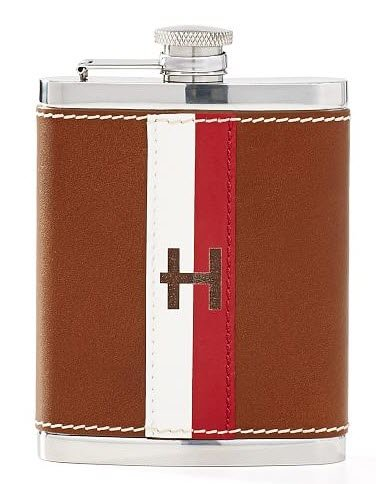 A leather flask with a red and white stripe
