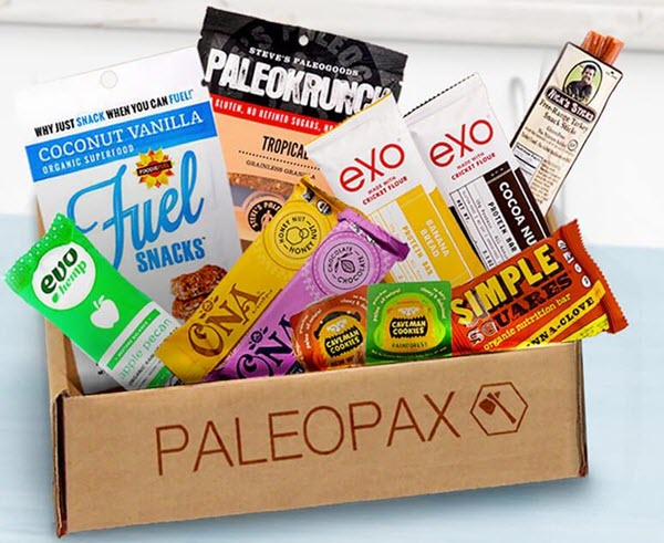 A cardboard box with various paleo snacks