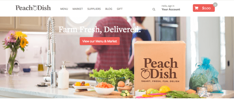Peach Dish Website Screenshot showing a family in the kitchen with a Peach Dish box and various fruits and vegetables on the counter
