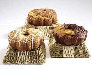 3 coffee cakes on upside down baskets