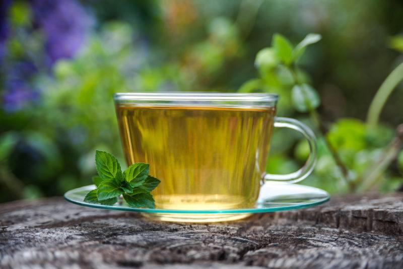 A glass mug full of peppermint tea
