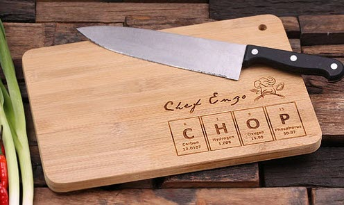 Cutting board and a knife, with the letters CHOP engraved onto the board.