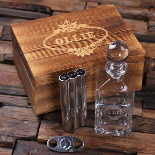 A whiskey decanter, cigar/flask, cigar cutter and engraved box
