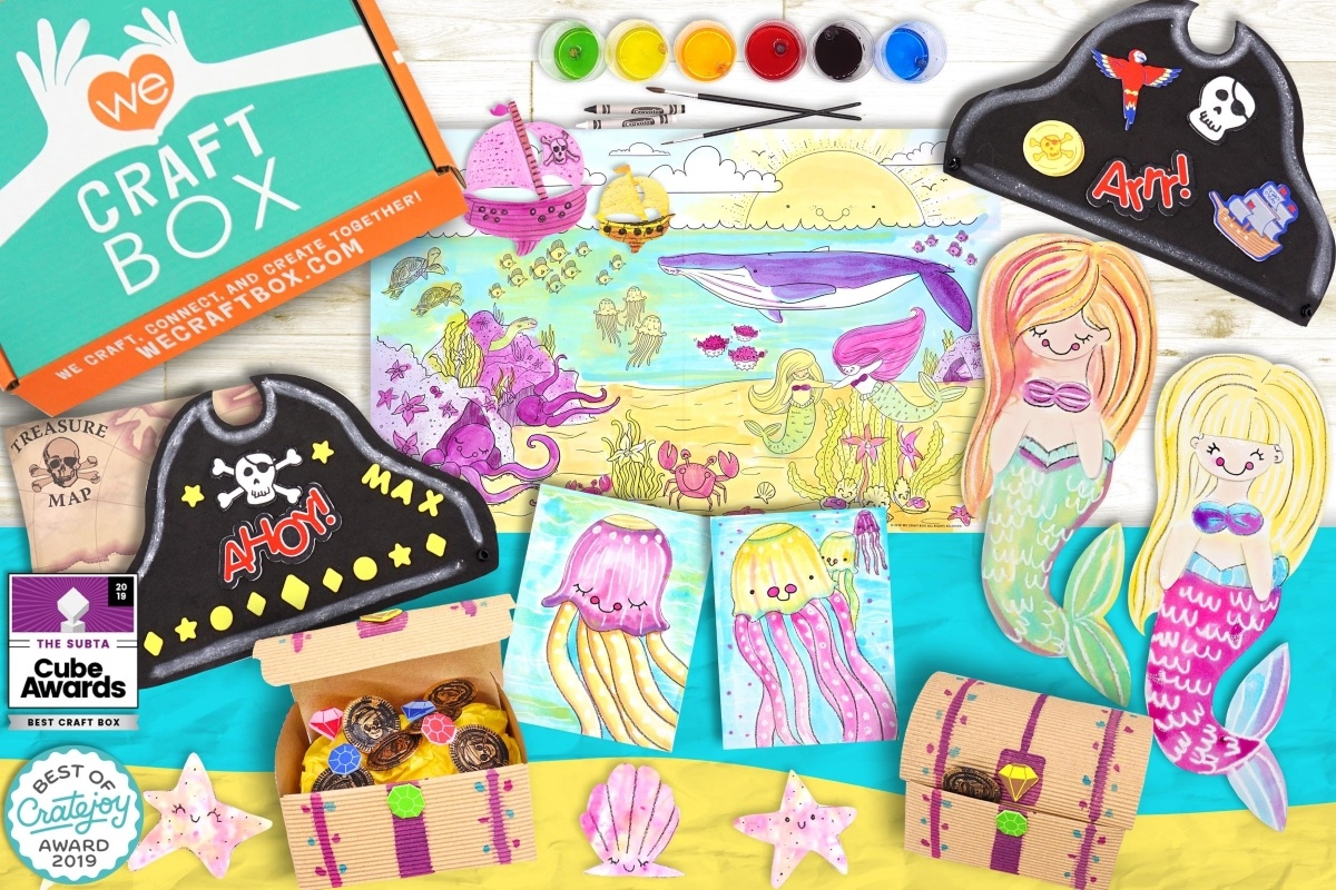 photo of We Craft Box in the upper left corner with paints, paint brushes a pictures and cut outs for crafting