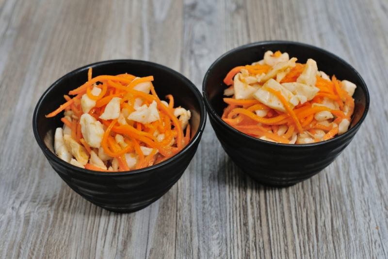 Two black bowls of picked vegetables