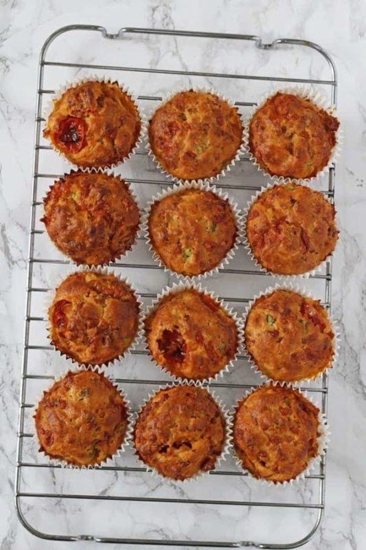 A cooking tray with 12 muffins drying