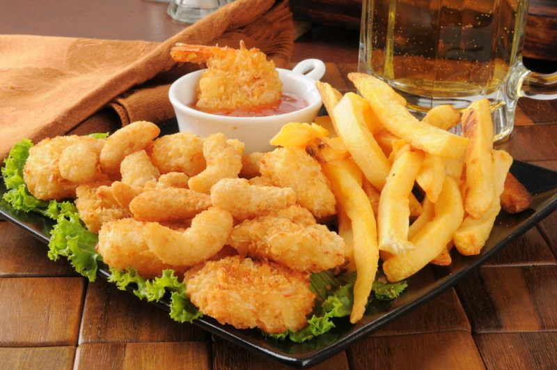 Popcorn and coconut shrimp with fried chips