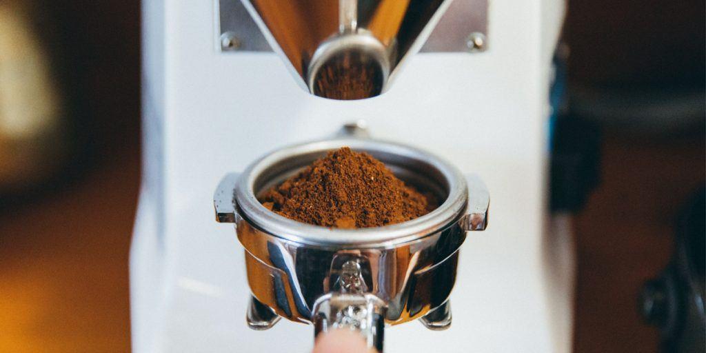 Portafilter full of finely ground espresso