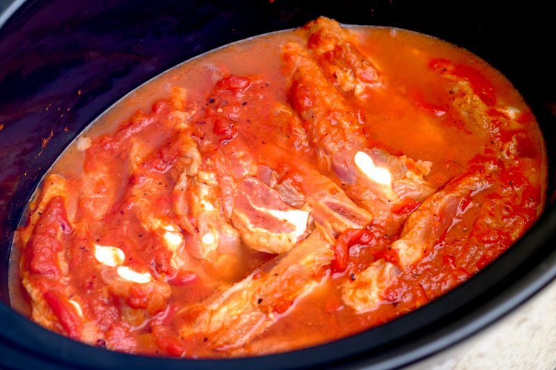 place ribs in slow cooker