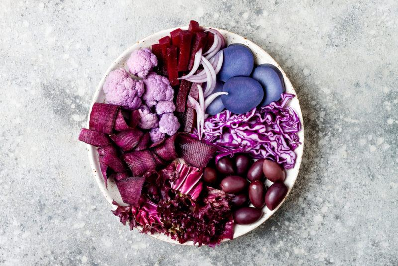 A white bowl with purple vegetables