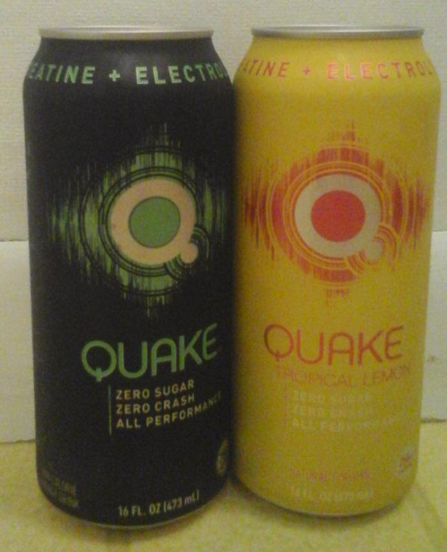 A black and green Quake can, next to a yellow and red one