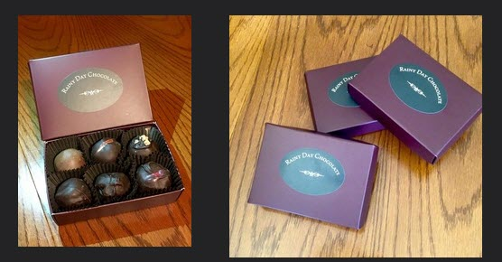 An open box of 6 truffles and 3 closed boxes