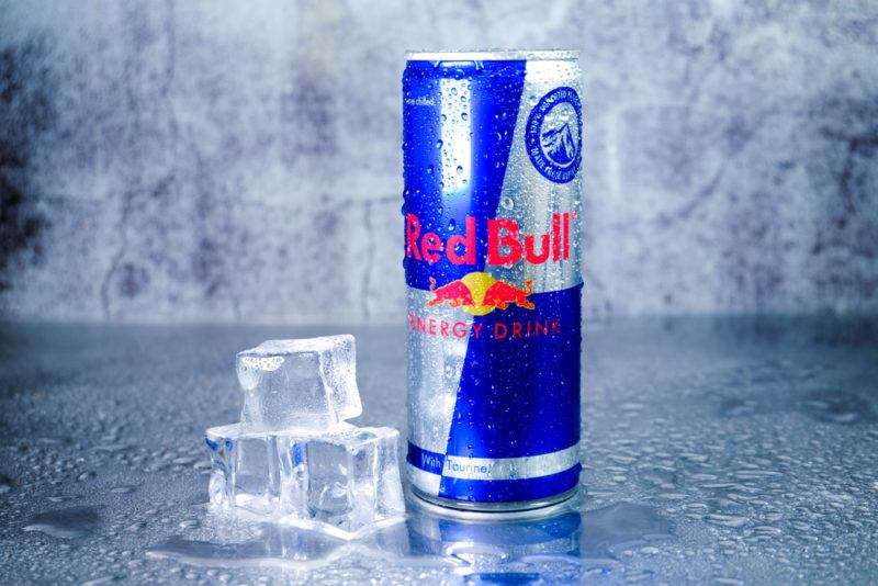 Red Bull energy drink next to ice