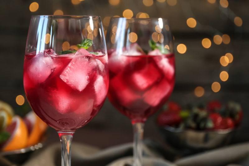 Wine glasses containing red wine spritzer