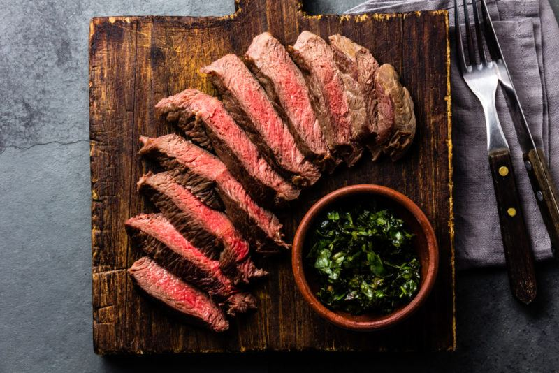 Sliced red meat on a wooden board