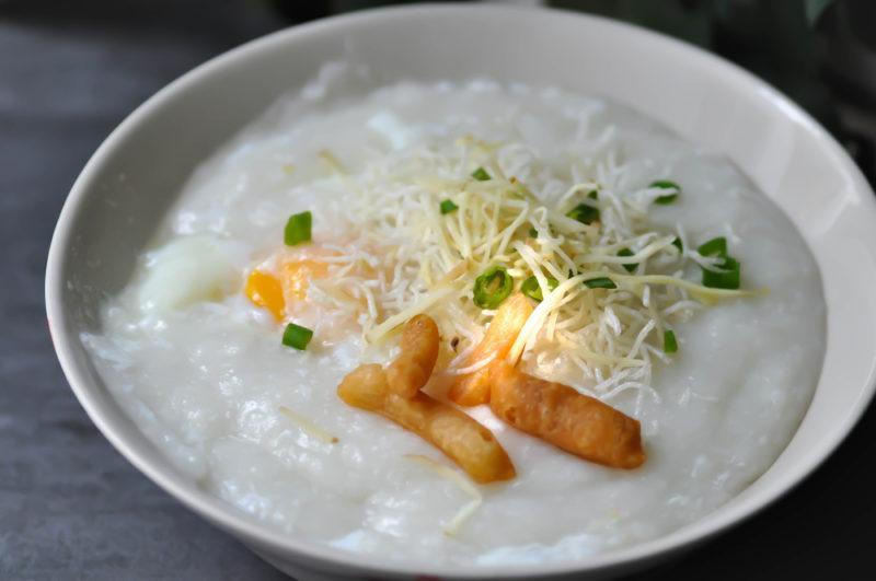 A white bowl of rice porridge