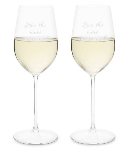 Two glasses half filled with white wine