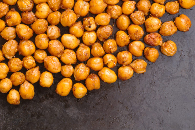 Roasted chickpeas on a gray-black background
