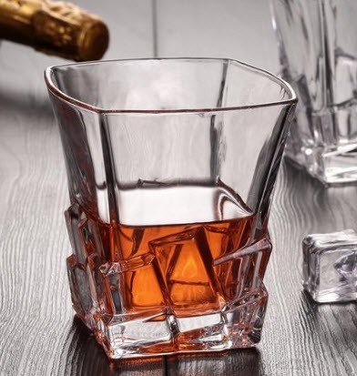 A square whiskey glass with interesting shapes