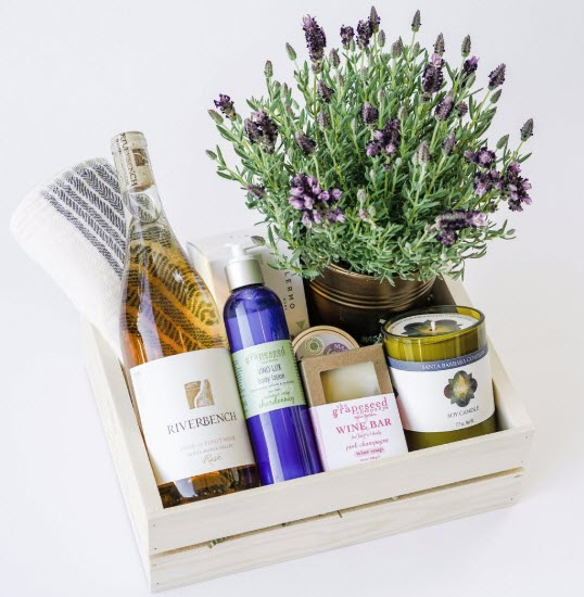 Light box with wine, a candle and lavender