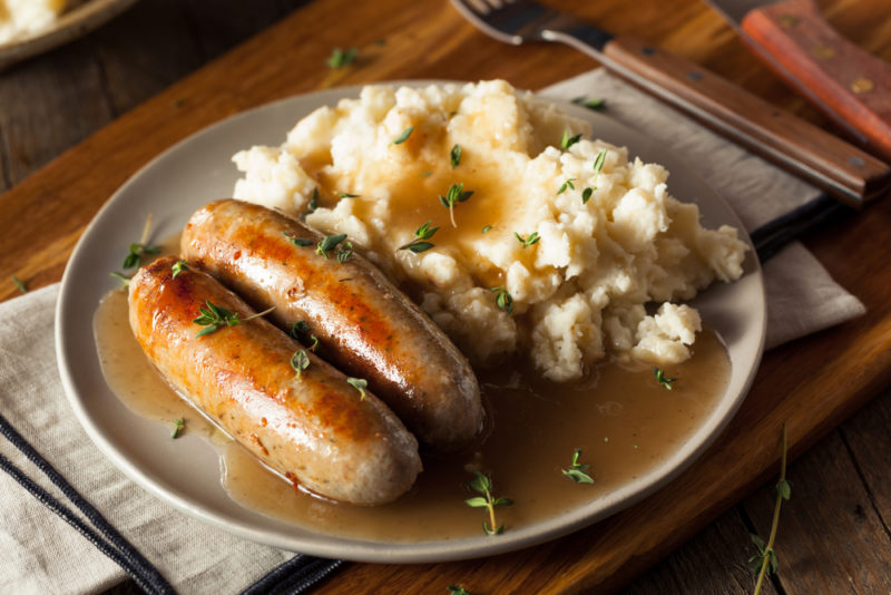 A plate with sausages and mash