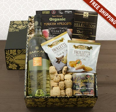 Cardboard gift box with wine, apricots and the likes
