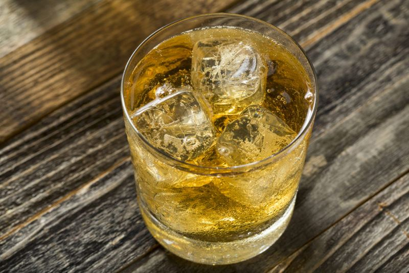 A lowball glass containing a scotch and soda