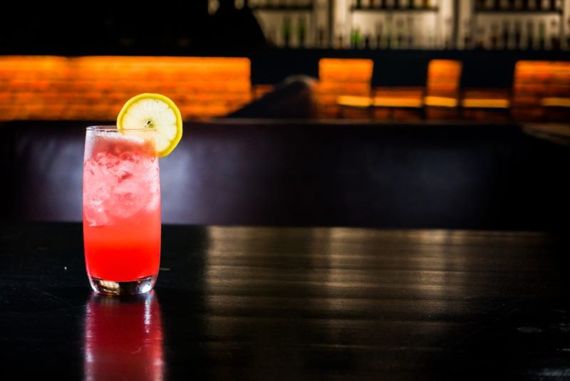 A sea breeze cocktail in the dark on a bar